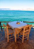 Greek outdoor restaurant with Mediterranean sea view(Crete, Gree — Stock Photo