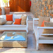 Beautiful mediterranean patio with white outdoor furniture - Stock Photo