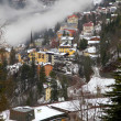 Houses and fog in Alps mountain resort village Bad Gastein — Stock Photo