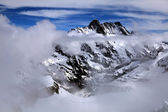 Jungfrau, Switzerland and cloudscape — Stock Photo