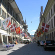Old street with flags in Bern, Switzerland — Stock Photo