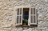 Rustic window with old wood shutters in stone rural house, Prove — Stock Photo