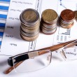 Glasses, financial graphics and euro coins — Stockfoto #29944755