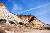 Red cliffs and blue sky (Algarve,Portugal) — Stock Photo