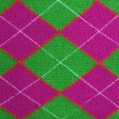 Lilac and green argyle pattern fabric — Stock Photo