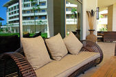 Sofa with cushion on terrace of summer resort — Stock Photo