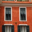 Red stucco house with old green shutter windows in Monaco — Stock Photo