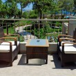 Rattan armchairs on terrace lounge in a luxury resort . — Stock Photo #30562547