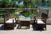 Rattan armchairs on terrace lounge in a luxury resort . — Stock Photo