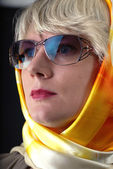 Woman in sunglasses and neckerchief — Stock Photo