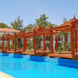 Stock Photo: Pool and wood pergola