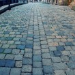 Old european street with cobblestone — Photo