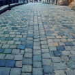 Old european street with cobblestone — Stock Photo