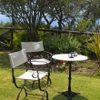 Stock Photo: Table and iron chairs in garden(Greece)