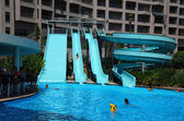 Water slide and pool — Stock Photo