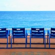 Blue empty chairs on Promenade des Anglais, Nice, France — Stock Photo