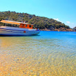 Small traditional ship on a sandy beach, Greece — Stock Photo