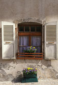 Rustic window with old wood shutters, Switzerland. — Stock Photo