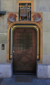 Wooden Ancient Door in Swiss City — Стоковое фото