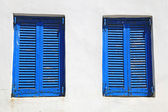 Vintage blue window with shutter (Greece) — Stock Photo