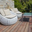 White outdoor furniture on wood resort terrace — Stock Photo