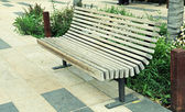 Modern wood bench on the city street — Stock Photo