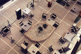 Tables and chairs in contemporary cafe, view from above — Stockfoto