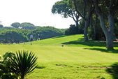Landscape of green golf course and golf players, Algarve, Portug — Stock Photo