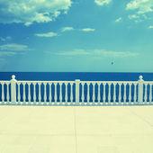 Empty terrace overlooking the sea — Stock Photo