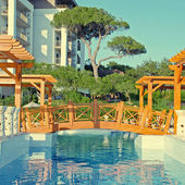 Summer resort with swimming pool — Stock Photo