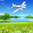 Meadow the sky and the plane — Stock Photo