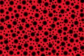 Red background with spots — Stock Photo