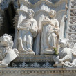 Stock Photo: Statues of evangelists Mark and Luke with their symbols (lion and bull)