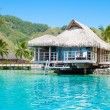 Paradise overwater bungalow - Stock Photo