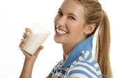 Young woman drink milk — Stock Photo