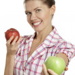 Stock Photo: Young woman showing apples