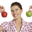 Young woman showing apples — Stock Photo
