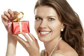 Young woman with a gift — Stock Photo