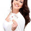 Young seductive woman play poker - Stock Photo