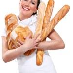 Young beautyful woman baker — Stock Photo