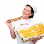Young beautiful woman showing homemade fresh pasta — Stock Photo #19671617
