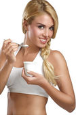 Beautiful woman eating fresh yogurt for breakfast — Stock Photo