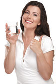 Young beautiful woman drinking a glass of water — Stock Photo