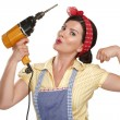 Stock Photo: Pretty funny girl struggling with some housework