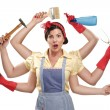 Stock Photo: Pretty very busy multitasking housewife on white
