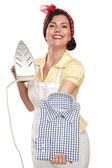 Happy beautiful woman housewife ironing a shirt — Stock Photo