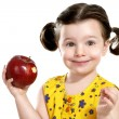 Pretty child holding a red apple in her hands — Stock Photo