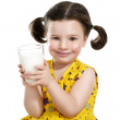 Pretty child holding a big glass of milk — Stock Photo #30932859