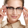 Stock Photo: Close up of young smiling beautiful womwearing eyeglasses