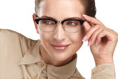 Close up of a young smiling beautiful woman wearing eyeglasses — Stock Photo